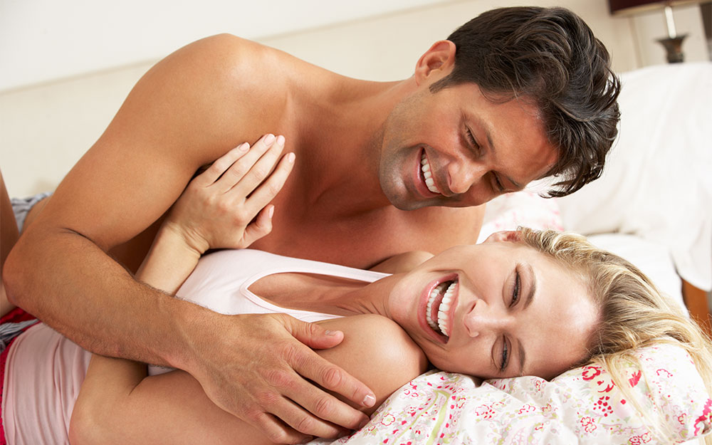 mid age couple having fun in bed